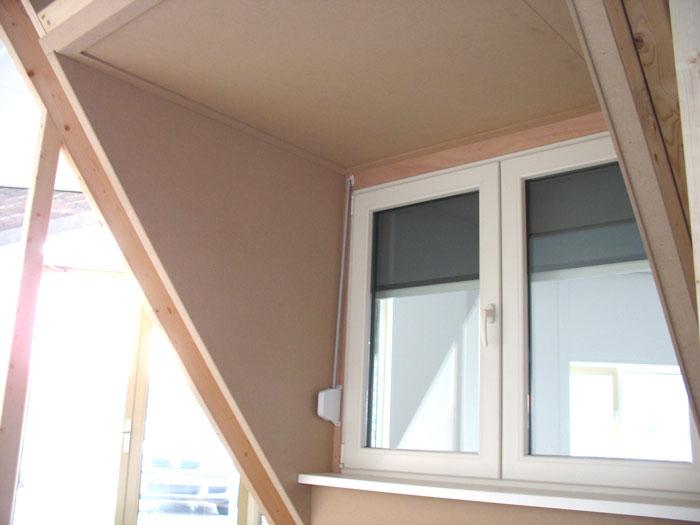 Voorbeeld van afwerking dakkapel met MDF-platen door Dak- en Woningcentrum